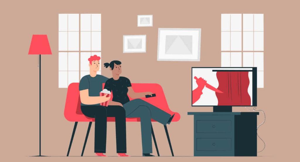 部屋で映画を見る男女